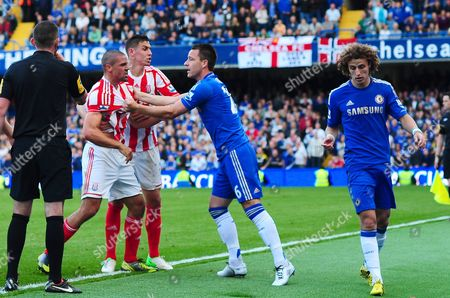 Stock Image of John Terry of Chelsea Holds Back an Angry Jonathan Walters of Stoke City From Confronting David Luiz After A Foul by Luiz Near the End United Kingdom London