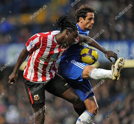 Kenwyn Jones of Sunderland Challenges For the Ball with Juliano Belletti of Chelsea United Kingdom London