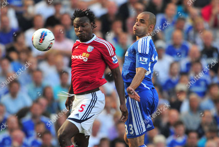 Alex of Chelsea and Somen Tchoyi of West Bromwich Albion in Action United Kingdom London