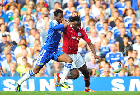 Mikel of Chelsea Takes On Somen Tchoyi of West Bromwich Albion United Kingdom London