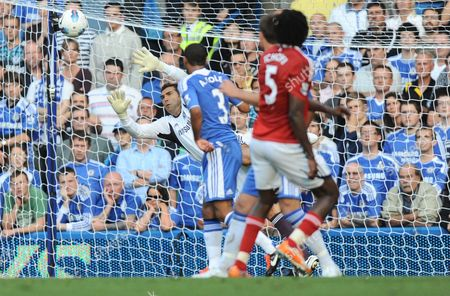 Chelsea Goalkeeper Henrique Hilario Denies Somen Tchoyi of West Bromwich Albion with A Flying Save United Kingdom London