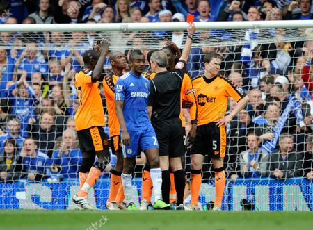Gary Caldwell of Wigan Athletic (right) Looks Dejected After Being Sown the Red Card by Referee Martin Atkinson For His Foul On Frank Lampard of Chelsea United Kingdom London