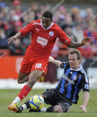 Sanchez Watt of Crawley Town is Tackled by Glenn Whelan of Stoke City United Kingdom Crawley