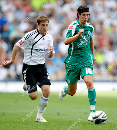 George Boyd of Peterborough United is Chased by Stephen Davies of Derby County United Kingdom Derby