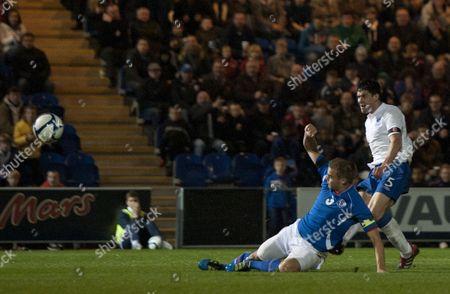 Martin Kelly of England U21 Scores A Goal Past A Sliding Holmar Orn Eyjolfsson of Iceland U21 United Kingdom Colchester