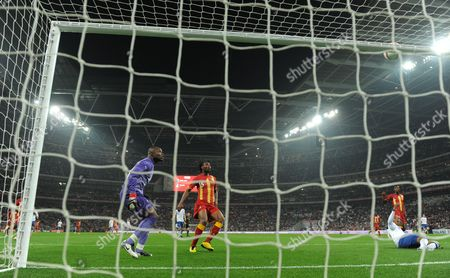Stock Image of Ghana Goalkeeper Richard Kingson Watches As Ashley Young of England Puts the Ball Over the Crossbar United Kingdom London
