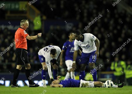 Referee Mr Peter Walton Holds out His Empty Hand Towards Jordon Mutch of Birmingham City Walton Booked Mutch in the Game Without Showing Him A Yellow Card United Kingdom Liverpool