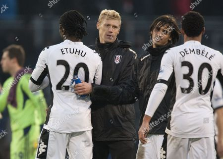 Stock Photo of Pavel Pogrebnyak of Fulham Shakes the Hand of Team-mate Dickson Etuhu at Full-time United Kingdom London