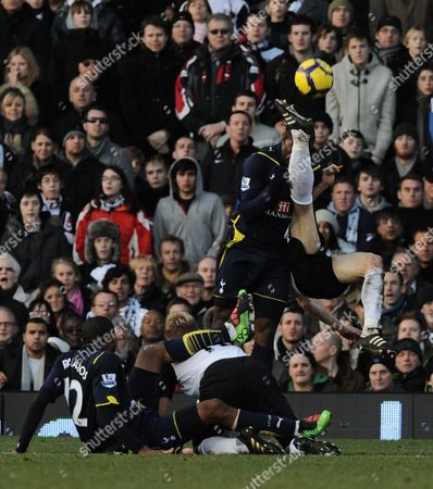 Stock Image of Sebastian Bassong of Tottenham Hotspur Gets A Kick in the Head Near the End and is Forced Off United Kingdom London
