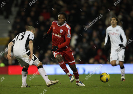 Stock Image of Somen Tchoyi of West Bromwich Albion in Action with Danny Murphy of Fulham As Bryan Ruiz Looks On United Kingdom London