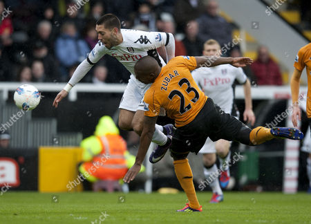 Clint Dempsey of Fulham is Fouled by Ronald Zubar of Wolverhampton Wanderers United Kingdom London