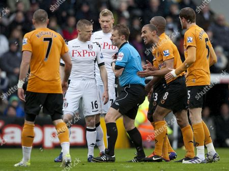 Karl Henry of Wolverhampton Wanderers Screams at Referee Mike Jones About Him Giving Team-mate Ronald Zubar A Yellow Card For His Foul On Clint Dempsey of Fulham United Kingdom London