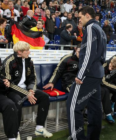 Michael Ballack of Germany Lays the Shirt of Robert Enke On Spare Seat On the Substitute Bench Before the Game - Photo Firosportphoto/back Page Images Uk Sales Only Germany Munich