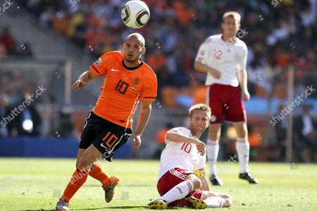 Wesley Sneijder of Holland Gets Away From Martin Jorgensen of Denmark South Africa Soweto, Johannesburg
