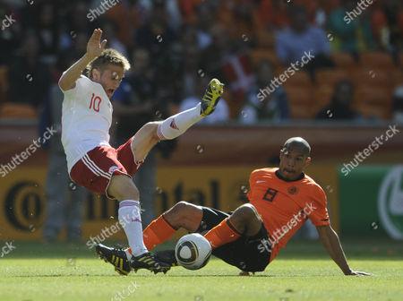 Nigel De Jong of the Netherlands Takes On Martin Jorgensen of Denmark South Africa Soweto, Johannesburg