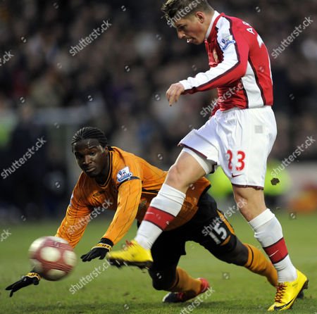 Andrey Arshavin of Arsenal Scores the First Goal As Bernard Mendy of Hull City Falls Over United Kingdom Hull