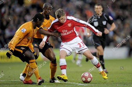 George Boateng and Bernard Mendy of Hull City and Andrey Arshavin of Arsenal with the Nike Aids Match Ball - Nike United Kingdom Hull