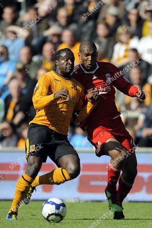 Bernard Mendy of Hull City and Ryan Babel of Liverpool United Kingdom Hull