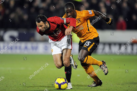 Bernard Mendy of Hull City is Turned by Ryan Giggs of Manchester United United Kingdom Hull