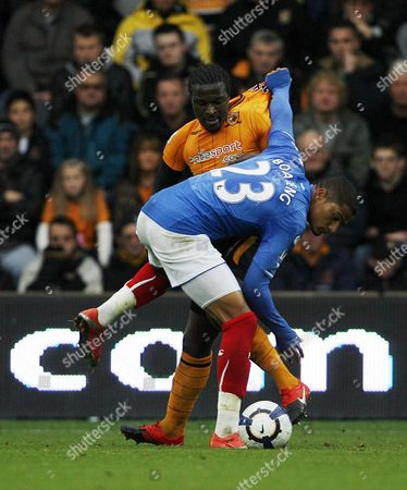 Bernard Mendy of Hull City and Kevin-prince Boateng of Portsmouth United Kingdom Hull
