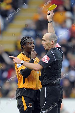 Referee Mike Dean Books Bernard Mendy of Hull City United Kingdom Hull