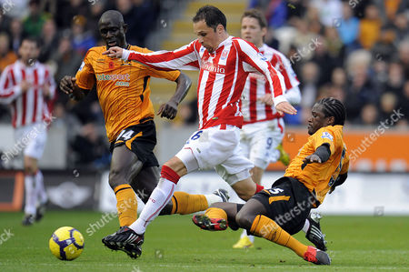 Seyi Olofinjana Watches As Team Mate Bernard Mendy of Hull City Brings Down Goalscorer Matthew Etherington of Stoke City and is Booked For the Tackle United Kingdom Hull
