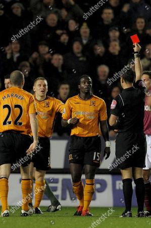 Bernard Mendy of Hull City is Sent Off by Referee Mark Clattenburg United Kingdom Hull