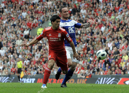 Luis Suarez of Liverpool Bursts Through to Set Up A Shot at Goal That Led to the Second Goal For Dirk Kuyt As Martin Jiranek of Birmingham City Tackles United Kingdom Liverpool