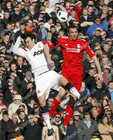 Dimitar Berbatov of Manchester United and Sotirios Kyrgiakos of Liverpool United Kingdom Liverpool