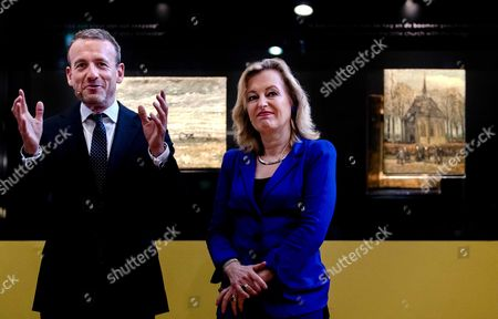Director of the Van Gogh Museum Axel Ruger (L) and Minister of Education, Culture and Science Jet Bussemaker reveal the two stolen Van Gogh in Amsterdam, the Netherlands, 21 March 2017. The paintings were recoverd in Napels, Italy, in September 2016 by the Italian police.