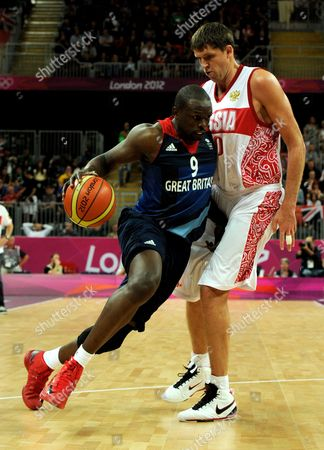 Luol Deng of Great Britain and Victor Khryapa of Russia During the Men's Preliminary Round Group B Basketball Match Between Russia and Great Britain in the Basketball Arena During the 2012 London Olympic Games in London England Uk - 29 July 2012