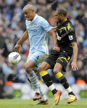 Vincent Kompany of Manchester City and David N'gog of Bolton Wanderers United Kingdom Manchester