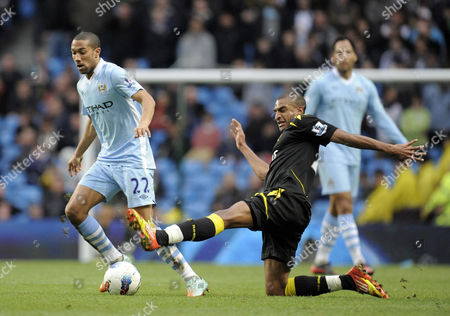 Gael Clichy of Manchester City Tackled by David N'gog of Bolton Wanderers United Kingdom Manchester