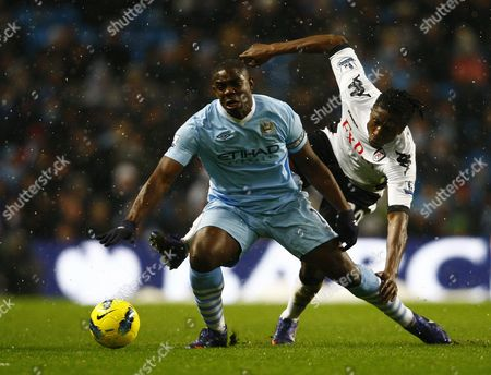 Micah Richards of Manchester City and Dickson Etuhu of Fulham United Kingdom Manchester