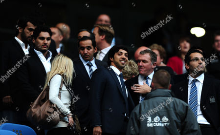 Manchester City Owner Sheikh Mansour Talks to Chief Executive Garry Cook Front Row 2nd Right and Chairman Khaldoon Al Mubarak Right As A Blonde Lady Passes Between Them and Members of Mansour's Entourage On His First Visit to the City of Manchester Stadium United Kingdom Manchester