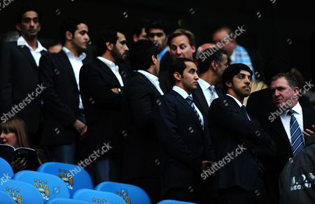 Manchester City Owner Sheikh Mansour Talks to Chief Executive Garry Cook Front Row Right As Members of Mansour's Entourage Stand Behind Him On His First Visit to the City of Manchester Stadium United Kingdom Manchester