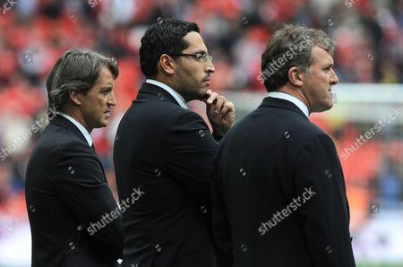 Stock Photo of L-r Manchester City Manager Roberto Mancini Chairman Khaldoon Al Mubarak and Chief Executive Garry Cook United Kingdom London