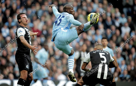 Mario Balotelli of Manchester City Controls the Ball As Stephen Taylor of Newcastle United Looks On United Kingdom Manchester