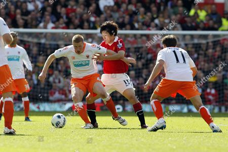 Ji Sung Park of Manchester United and Keith Southern of Blackpool United Kingdom Manchester