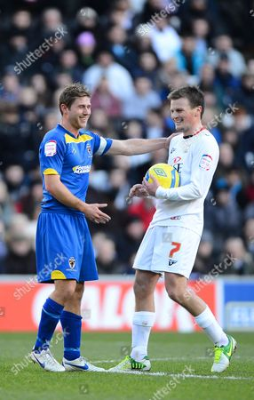 Stacy Long of Afc Wimbledon and Stephen Gleeson of Mk Dons All Smiles After Previously Grappling For the Ball