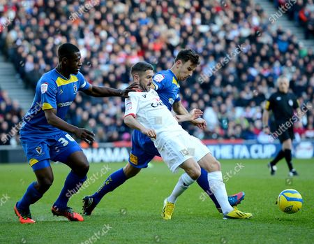 Ryan Lowe of Mk Dons Tangles with Yado Mambo and Steven Gregory of Afc Wimbledon