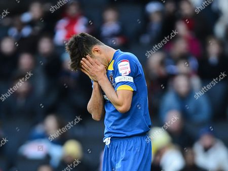 Stock Picture of A Dejected Steven Gregory of Afc Wimbledon
