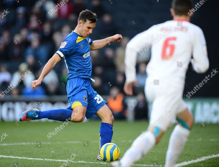 Steven Gregory of Afc Wimbledon Scuffs This Effort Wide Missing the Chance to Put His Side in the Lead Moments Before Jon Otsemobor of Mk Dons Scores the Winning Goal