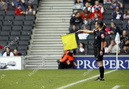 Assistant Referee Amy Rayner Raises Her Flag