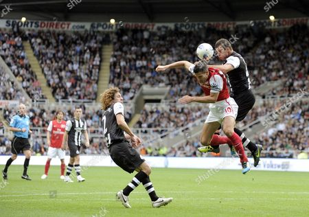 Stephen Taylor of Newcastle United and Robin Van Persie of Arsenal at St James Park Newcastle United Kingdom Newcastle