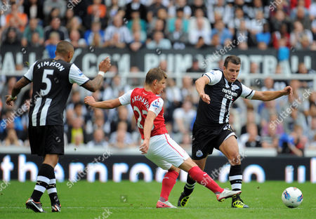 Stephen Taylor of Newcastle United Beats Andrey Arshavin of Arsenal United Kingdom Newcastle