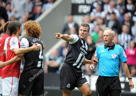 Referee Peter Walton Has Gervinho of Arsenal Pointed out by Stephen Taylor of Newcastle United After the Arsenal Player Appeared to Put A Hand in Joey Barton of Newcastle United's Face United Kingdom Newcastle