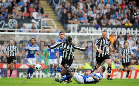 Stock Image of Nile Ranger of Newcastle United is Fouled by Martin Jiranek of Birmingham City Who Was Booked United Kingdom Newcastle