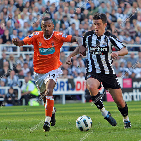 Elliot Grandin of Blackpool and Joey Barton of Newcastle United United Kingdom Newcastle