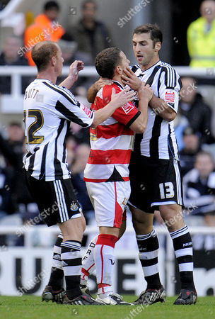 Zurab Khizanishvili of Newcastle United Was Sent Off For Grabbing Doncaster Rovers Billy Sharp by the Throat United Kingdom Newcastle
